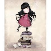 muñeca encima de libros