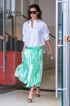 Fashion designer Victoria Beckham seen leaving her Manhattan hotel on September 13, 2016 in New York City, New York.  She had a mint green skirt on and had a mint green bag in her hands.