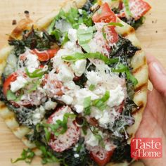 Smoky Grilled Pizza with Greens & Tomatoes is part of Grilled pizza - This smoky grilled pizza scores big with me for two reasons It encourages my husband and son to eat greens, and it showcases fresh produce —Sarah Gray, Erie, Colorado Tasty Videos, Food Videos, Grilling Recipes, Cooking Recipes, Grilled Pizza Recipes, Cooking Tv, Vegetarian Grilling, Healthy Grilling, Barbecue Recipes