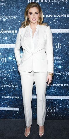 Kate Upton suited up at the 2014 Women's Leadership Award honoring Stella McCartney in a smart white suit separates that she paired with a printed blouse, a gold timepiece and satin peep-toes.