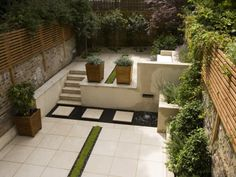Contemporary Classic Garden with Planted Rill, Copper Water Feature, Limestone Paving and Steps Other