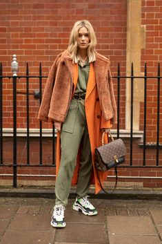 LONDON, ENGLAND - FEBRUARY 18: A guest is seen on the street during London Fashion Week February 2019 wearing JW Anderson with Louis Vuitton bag on February 18, 2019 in London, England. (Photo by Matthew Sperzel/Getty Images)