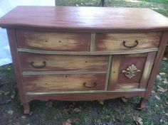 Restyled Vintage Designs in Indiana painted this dresser in Saddle and Amber Waves of Grain.  It's waiting for new knobs but it sure is cute!