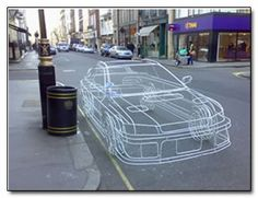 That car rendered from what looks like vector graphics from an old-school arcade game is a wire-frame sculpture by artist Benedict Radcliffe. And we mean an actual frame made of wires.