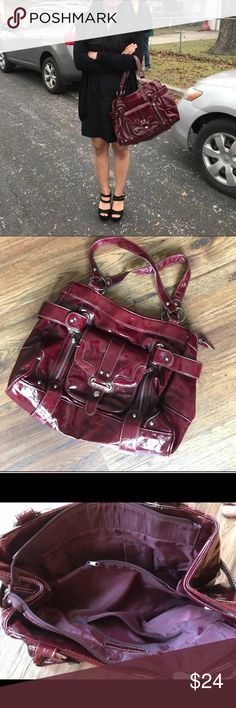 """Large Burgundy Chinese Laundry Purse Inside are two main storage sections with a center zipper pocket that duals as a """"divider"""" to easily separate multiple items. In total, there are 7 pockets, 5 with zippers and two without. Perfect for women who carry a lot of things or for women who simply prefer an attractive accessory. There is a small cut at the bottom, however, the tear does not penetrate through the cardboard lining or the fabric of the purse. See photos for details. Other than that…"""