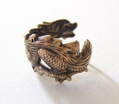 Dragon Ring Adorable dragon wraps around finger by chinookhugs