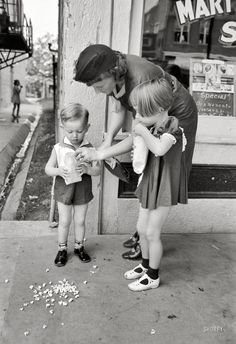 Mother and children with popcorn, National Rice Festival, Crowley, Louisiana 1938