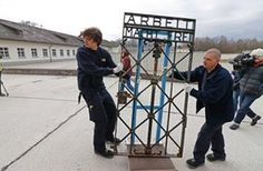 Dachau, Germany Two men move the original iron gate in the grounds of the former Nazi concentration camp in Dachau