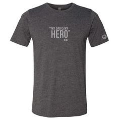 """Mark Wahlberg says it best - """"My Dad Is My Hero"""". Featuredon the front of a Charcoal Grey T-shirt with the Wahlburger logo on the left sleeve, thissuper-soft"""