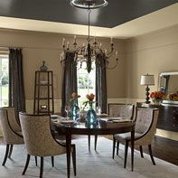Traditional dining room in soft neutrals.  Notice the dark ceiling and window treatments...smart use of color.