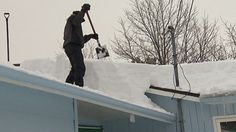 Woman trapped when roof collapses under heavy snow and ice