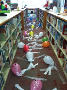 A Sea of Jellies! Balloons and streamers make for a fun activity the children do while they go on a treasure hunt through the library. - Summer Reading 2013