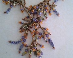 Wisteria Necklace-Bead woven necklace-flowers and leaves eleganty surround your neck in purple and amber with muted matte spring green leave