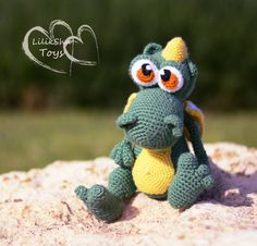 THIS IS A CROCHET PATTERN WITH PICTURES FOR MAKING A TOY, NOT A TOY INSELF. This is a crochet pattern with pictures for making a toy, not a toy itself. ======================================== Little dragon. The Dragon can stand and sit Dragons height: 18 cm. (7.1) Chinese symbol of 2012