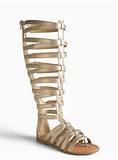 """<p>You can't step into the style arena without these gladiator sandals! The knee-high cage strap design is disco-glam with gold metallic faux leather (they have a hint of stretch as well). Zip back.</p>  <ul> <li style=""""list-style-position: inside !important; list-style-type: disc !important"""">TRUE WIDE WIDTH: Designed so you never have to size up again. For the perfect fit, we recommend going down a whole size.</li><li style=""""list-style-position: inside !important; list-style-type: disc…"""