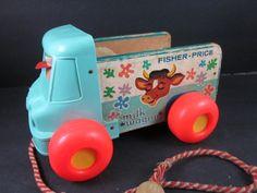 vintage 1965 fisher price pull toy, milk wagon, truck. via Etsy.