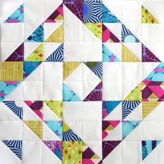A deliciously scrappy Nip Tuck quilt block by Molli Sparkles. Tutorial from the Modern HST Sampler QAL.