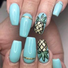 These detailed pineapple designs look gorgeous on top of a baby blue base coat; perfect for an elegant summer design. #summernails