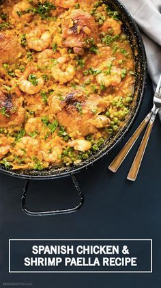 Spice up your family's weeknight dinner with this flavorful Spanish Chicken and Shrimp Paella recipe. This homemade paella is made with fresh ingredients like saffron, chicken, shrimp, garlic, tomato, and garnished with fresh parsley. #eatclean
