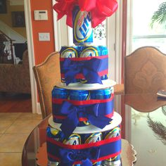 DIY beer cake, perfect for fathers day! 24 pack: 12 on bottom tier, 8 on middle, and 4 on top. Wrap each tier with a rubber band and cover with ribbon.