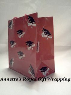 Handcrafted Red Petite Gift Bag w/Graduation Caps & Diploma Details. Size: (H)6.25 x (W)3.25 x (L)5.25 Item#ARGWGB4