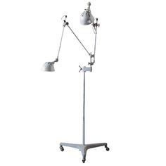 View this item and discover similar for sale at - This dual armed steel lamp by O. White sits on a rolling medical base on three castors. It adjusts and articulates in numerous ways-ideal for task lighting White Floor Lamp, Modern Floor Lamps, Task Lighting, Flooring, Steel, Antiques, House, Furniture, Home Decor
