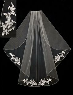 A wedding veil adorned with alencon lace appliques accented with and embroidered edge. It is flutter cut and 38 inches by 72 inches wide, on a four inch metal comb. Because this veil is made when you
