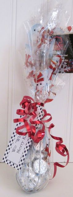 We Whisk You A Merry Kissmas! Simple & cute Christmas gift bag. A whisk w/ Hershey Kisses in it! Could put anything in the whisk, just change Kissmas to Christmas