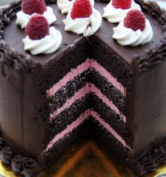 Chocolate Rasberry Cake. Looks incredible! Chocolate cake with raspberry mousse filling and ganache on top