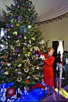First Lady Betty Ford decorating the White House residence Christmas tree.