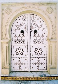 White door at the heart of the Medina.