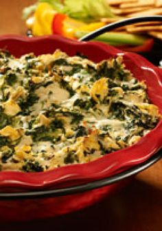 Savory Spinach-Artichoke Dip – Artichoke hearts and spinach are combined with Alfredo sauce, then baked with two kinds of cheese for an enticing appetizer. Party Dip Recipes, Potluck Recipes, Kraft Recipes, Appetizer Recipes, Appetizers, Cooking Recipes, Spinach Alfredo, Spinach Artichoke Dip, Artichoke Hearts