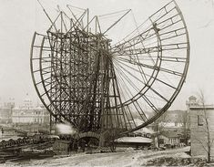 Constructing the huge Ferris wheel for the 1904 St. Louis World's Fair. I don't envy that guy standing on it.