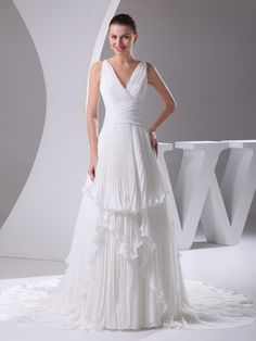 Deep V Neck A Line Chiffon Wedding Gown with Pleated Tiers Brands:TOSCAFreeship:YESFabric:ChiffonFabric(main):WeddingTailoring Time (Standard):15-20 DaysTailoring Time (Rush Order):10-15 DaysSilhouette:A-LineNeckline:V-neckShoulder Strap:Spaghetti…