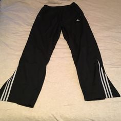 Men's black adidas Windbreaker pants Men's large black adidas Windbreaker pants with zippers on the bottom of leg. Has two pockets Adidas Pants Track Pants & Joggers