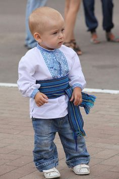 Ukrainian boy in traditional blouse and sach belt.