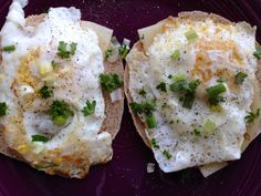 Fried organic, cage-free eggs resting on provolone cheese, atop gluten-free rounds. A dash of freshly ground black pepper, a pinch of sea salt, a whisper of diced green onion, a smidgen of minced fresh parsley, and you're good to go!