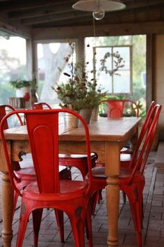 love those red chairs! SO neat with a barnwood table??