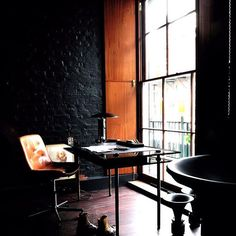 We are discussing and lusting after this dark and sexy London living space on A Life Designed right now! www.randysloan.com #industrial #interiordesign #roughluxe #darkinteriors #style #alifedesigned