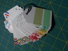 Washi tape on punched cardstock tags. I flip through the tags to see which washi I want to use and then go to my CTMH small organizer to retrieve it. I keep this hanging on an O-ring near my work space so I don't have to keep all the washi near my work space.