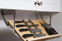 Counter space is a hot commodity in most kitchens, so rethinking the standard knife block (read: counter hog) with a cutting-edge under-cabinet knife storage system like this. (via Organize It)