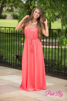 This elegant maxi is perfect for all of your formal occasions this summer! It features a v-neckine in front, a deeper v-cutout in back, a fabric tie with tassel around the waist, and spaghetti straps to top it all off. (We think the additional middle strap is so cute, too!) It's also sleeveless and is made of textured material in a trendy coral red!