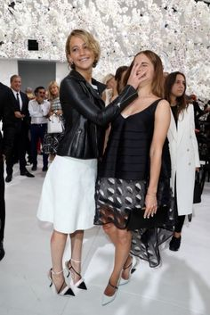 Jennifer Lawrence and Emma Watson seem to get along just fine at the Dior show earlier this week