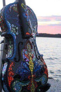 Old violin beautifully recycled using mosaics