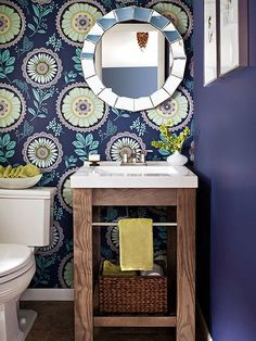 In a small bathroom, it's important to make use of all available space. Consider installing a vanity in a corner, which offers extra inches that might otherwise go unused. To keep the area from feeling dark, choose a light-color and open unit that has a built-in towel bar and a shelf for a storage basket./