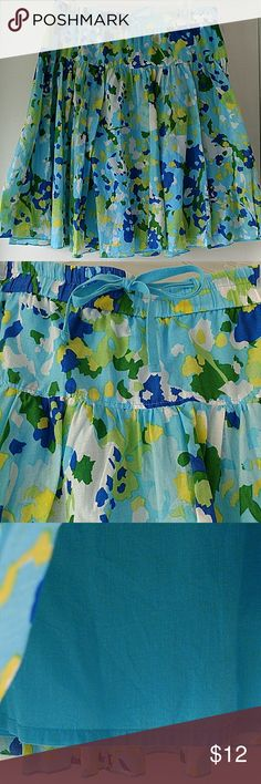Cute summery skirt in shades of blue size PM Petite Medium skirt with drawstring waist and solid pale blue underskirt for modesty. Cotton material with flowing shape. Blues, yellows, whites and greens. Perfect party skirt! Skirts