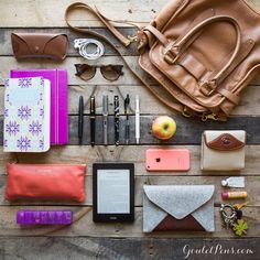 Caitlin shows her style in this week's #WhatsInMyBag ! Organization is a top priority for this bride-to-be so her May Designs Planner and #Filofax notebook are always close by. She keeps color coordinated notes with a #Pilot Vanishing Point, Pilot Custom 743, a #Lamy Safari, #Noodlers Konrad, a reliable Pilot G2, and Lamy rollerball. An apple keeps her satiated throughout her long day of work and play. What do you like most about Caitlin's style?