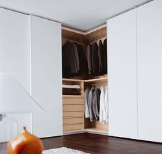 Awesome Corner Wardrobe With Sliding White Door Design Feat Compact Storage Drawers And Clothes Rod Pretty For Simple Bedroom Wall Shelf