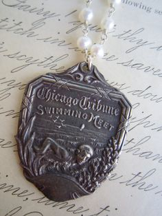 vintage recycled repurposed Chicago tribune swim meet medal on sterling silver wire wrapped pearl necklace