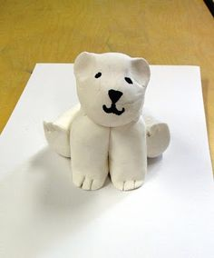model magic polar bears. Sphere head, potato shape body, 4 logs for limbs. Use scissors to cut toes, sharpie for eyes, nose, etc. Study different polar bear poses and let kids choose.
